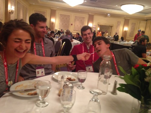"""This is a picture from dinner at the Chicago Marathon. Patrick is on the right, and Alexi was feeding her """"brother"""" as part of our dysfunctional family we made up that day....long story!"""