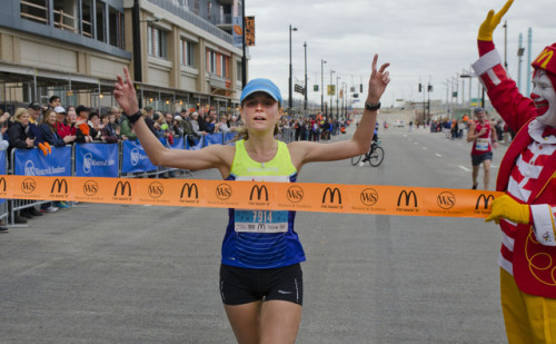 Women's winner Tina Muir of Lexington, KY prepares to cross the finish line on Second Street during 106th Thanksgiving Day Race and Walk Thursday November 26, 2015 in Downtown, Cincinnati. Photo by Joseph Fuqua II for WCPO